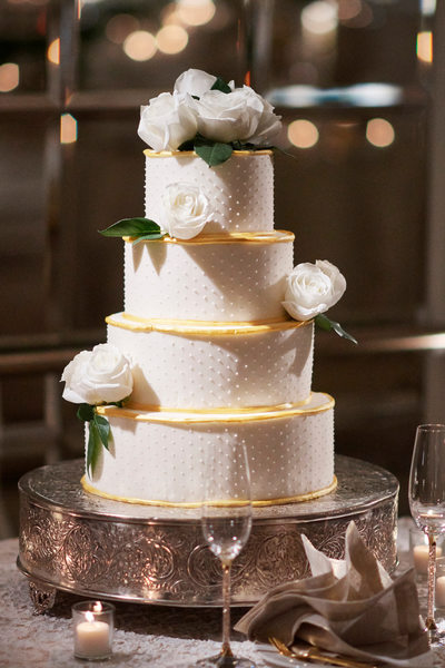 Cream Dot Gold Wedding Cake Accented with White Roses