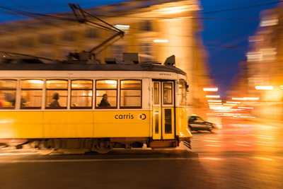 Classic yellow tram in Lisbon, Portugal - Stock Photo