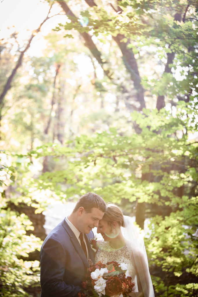 Wedding in the Woods: Sunlit Bride and Groom Portrait