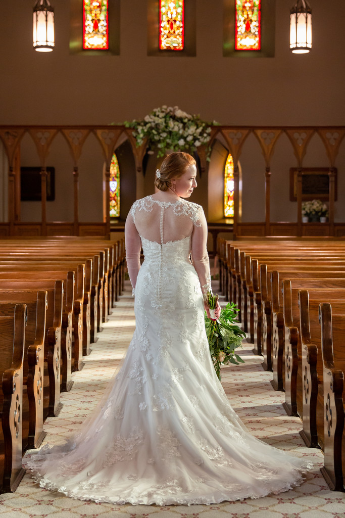 Old Calvary Church photo of bridal portrait in aisle