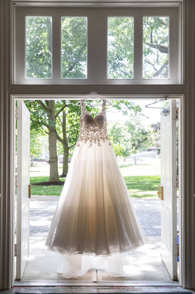 Wedding Detail Photos: Bride Dress Hanging in Doorway