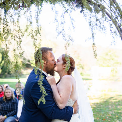 Outdoor Ceremony: First Kiss Under Arch