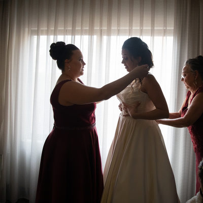 Bride Getting Ready with Family Silhouette
