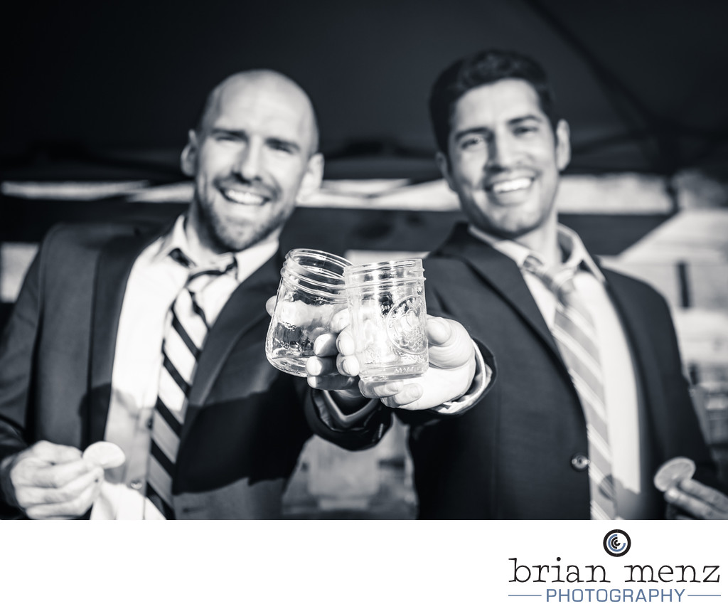 grooms toasting on wedding day gay LGBT wedding michigan