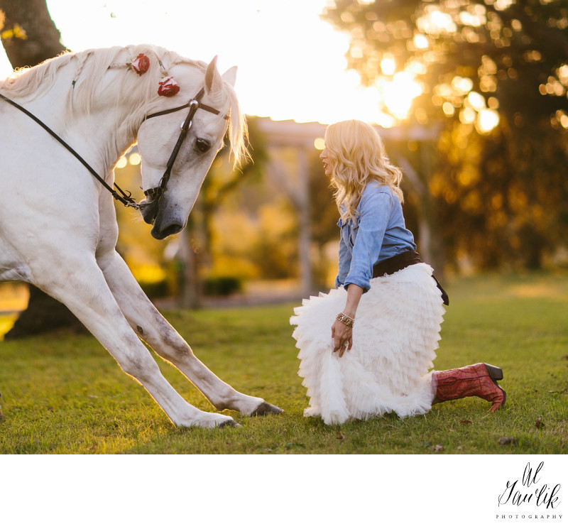 Horse Bowing and Bride Kneeling Create Memorable Image