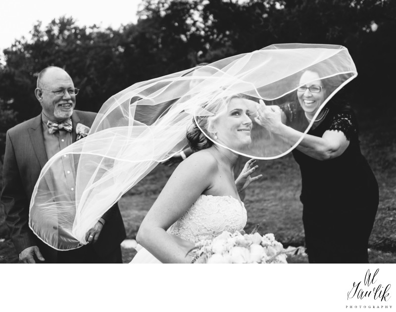 Texas wedding photographer Wind whipped bride smiles