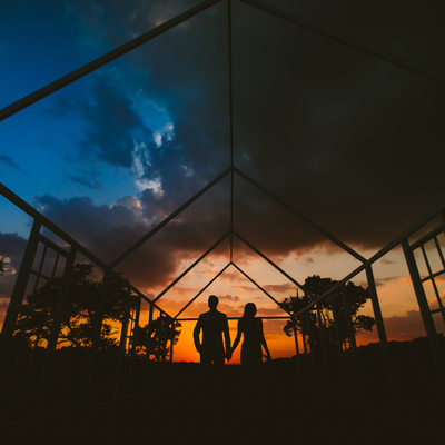 Dripping Springs Wedding Venue sunset frames newlyweds