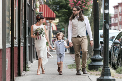 Bride Groom and son go for a walk