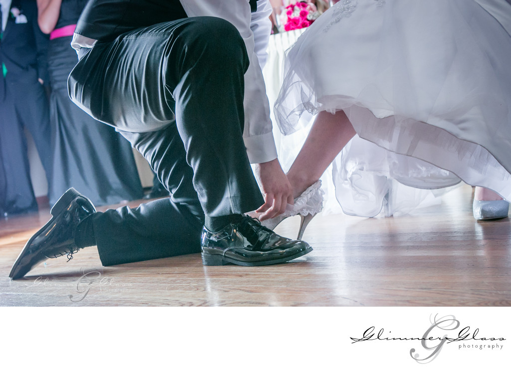 Garter Moment wedding photography at Antheia Ballroom