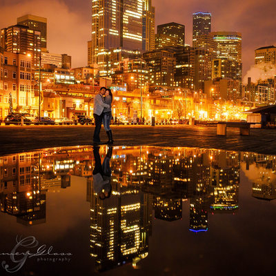engagement night photography with reflection pool