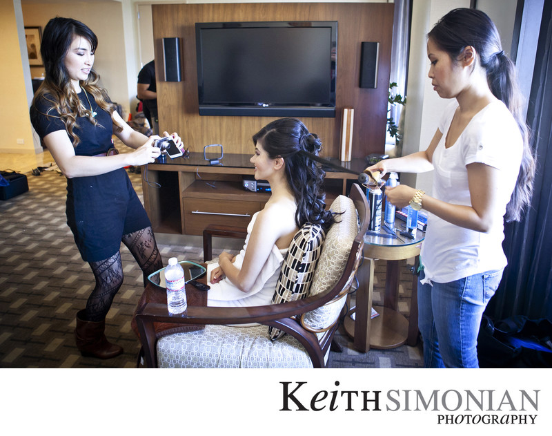 Photos of the Bride having her hair and makeup done