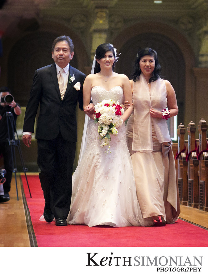 Bride walks up the church aisle