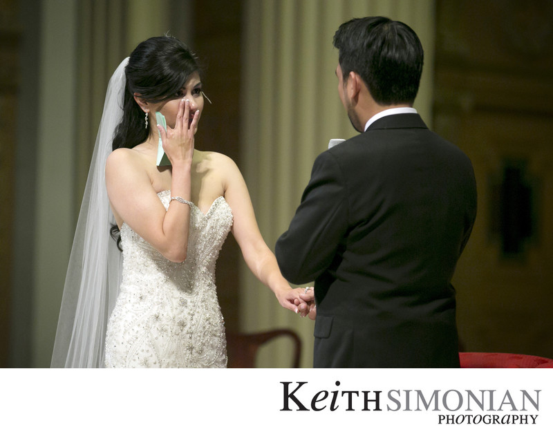 Bride wipes away tears during the wedding ceremony