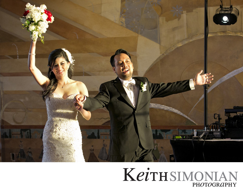 Bride and Groom wave to guest as they enter reception