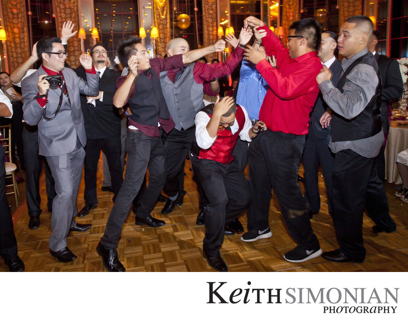 Single guys trying to catch the Bride's garter