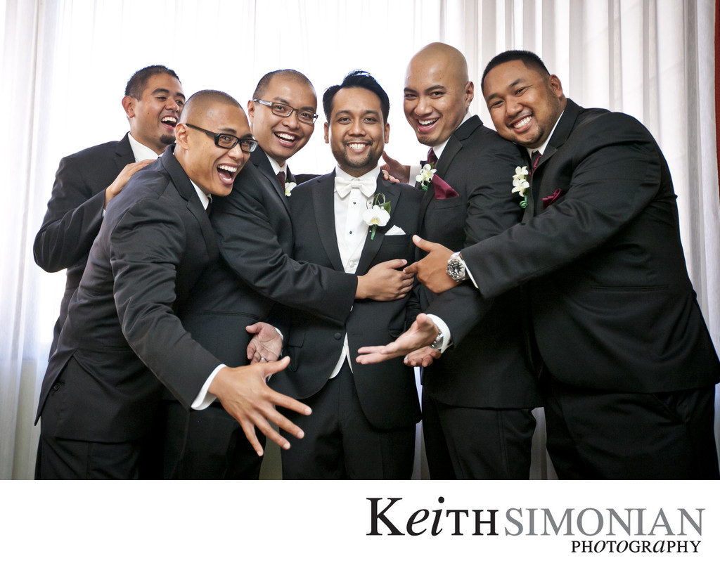Groomsmen hugging the groom
