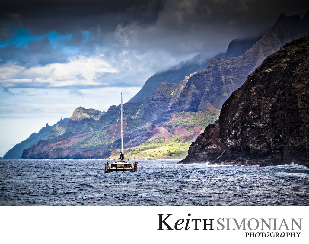 Catamaran sailing along Na Pali Cliffs at Kauai Hawaii