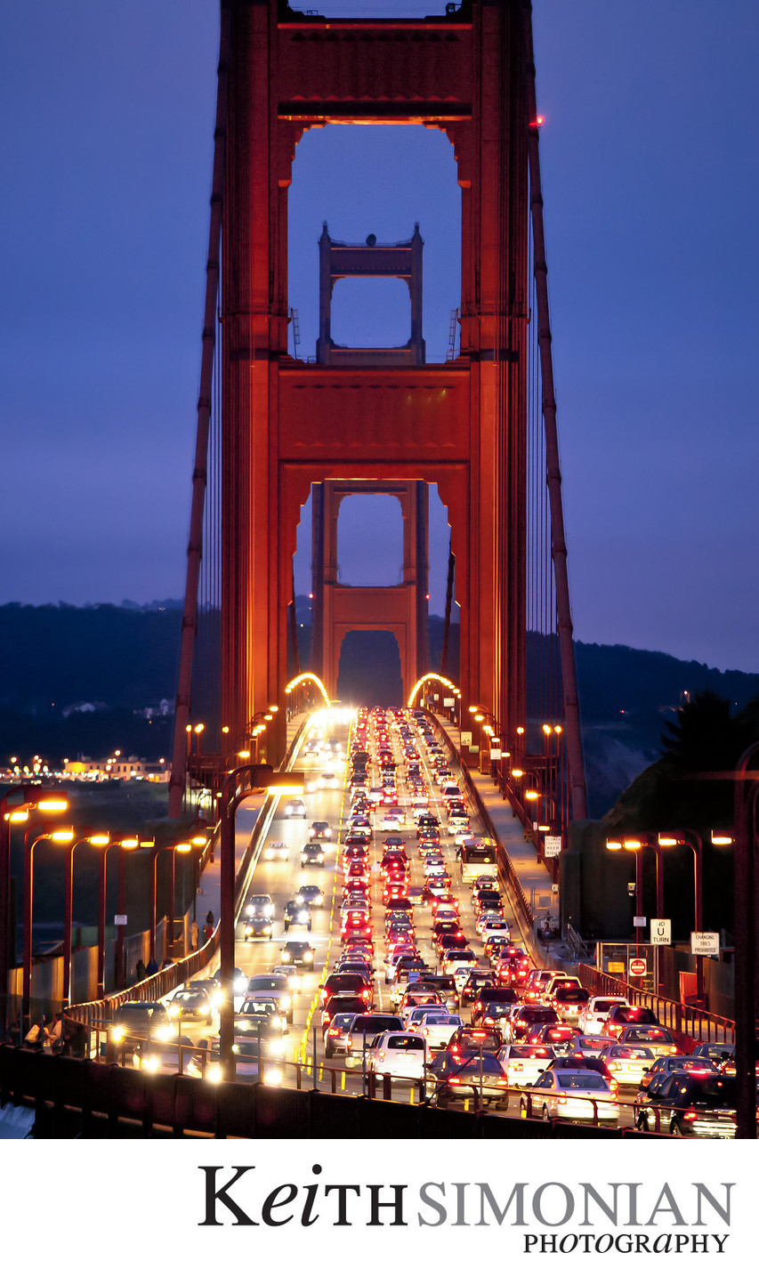 Golden Gate Bridge at twilight with rush hour traffic
