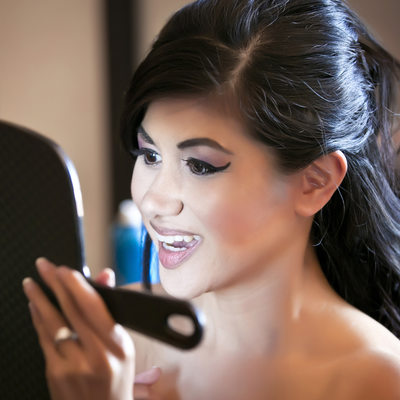 Bride getting ready looking in Mirror