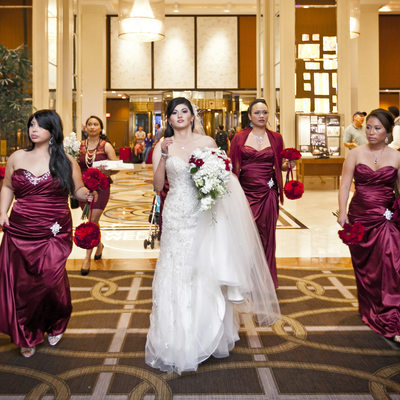 Bridal party walking through lobboy of Westin St Francis