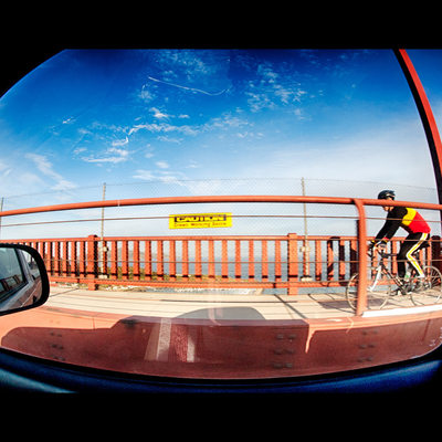Cyclist riding on the Golden Gate Bridge walkway