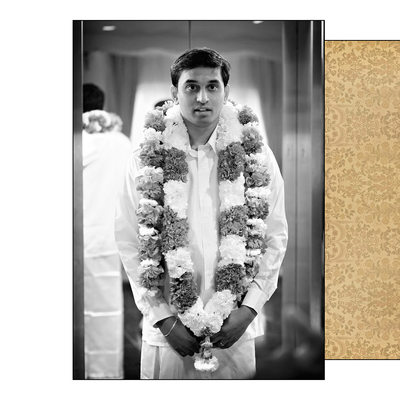 Groom wearing jaimala flower garlands