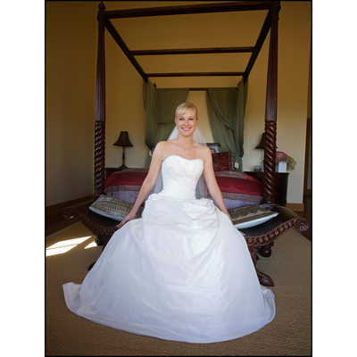 Full length portrait of Bride on Bed