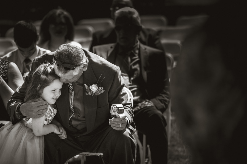 Flowergirl with grandfather candid moment