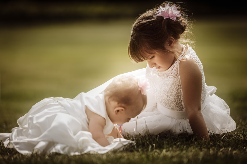 Flower girls in grass