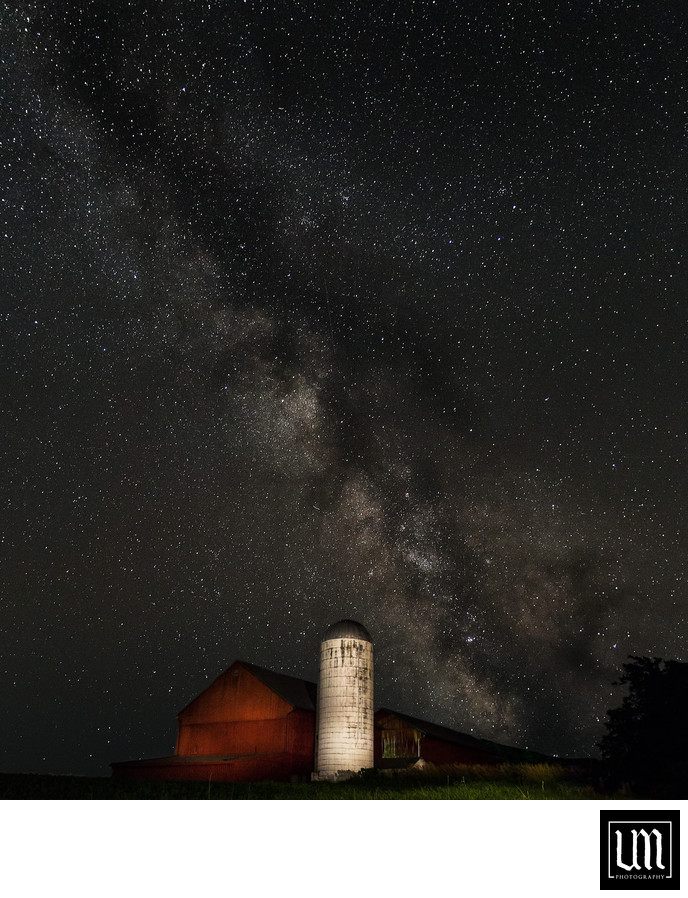Milky way over red barn