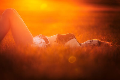Laying in field during sunset