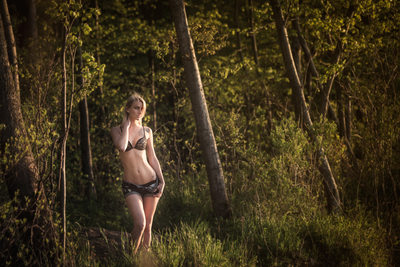 Blonde woman posing in forest