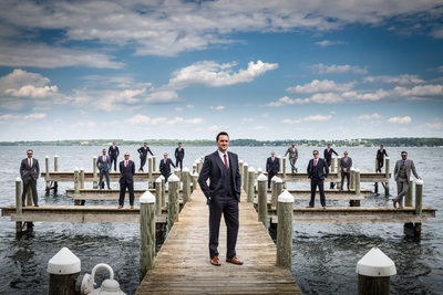 Groomsmen on boat dock at Belhurst Castle