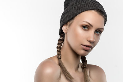 Blonde with pigtails in beanie