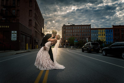 Groom dipping Bride in middle of city street