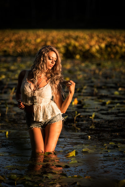 Beautiful portrait in water at sunset