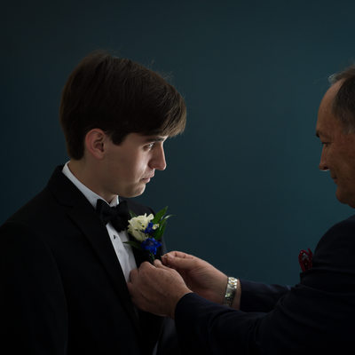Groom with Boutonnière Being Pinned by His Father