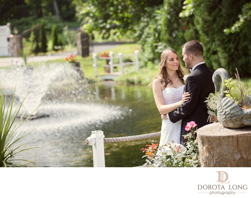 Wedding couple standing by a fountain danbury