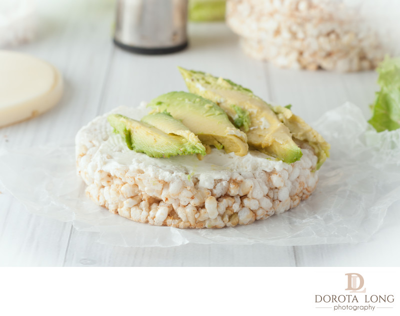 rice cake with cream cheese and avocado