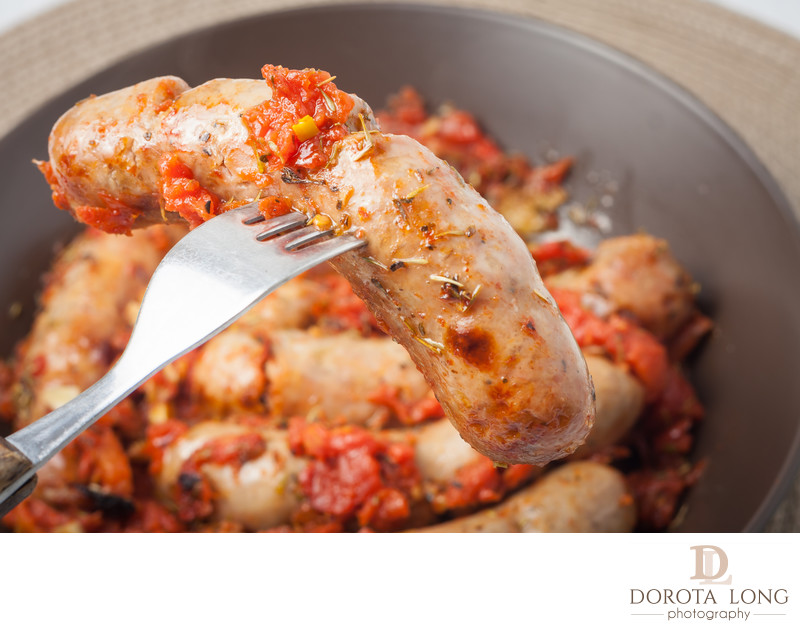 oven cooked sausages with tomatos, garlic and italian herbs