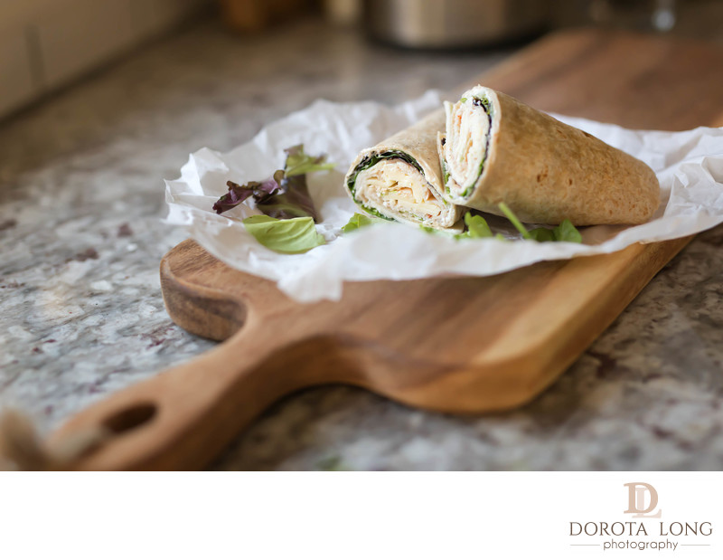 a healthy wrap with turkey, greens and cheese made with whole grain tortilla wrap