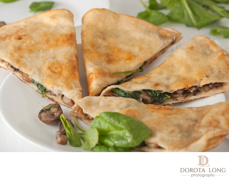 mushroom spinach quesadilla on white plate
