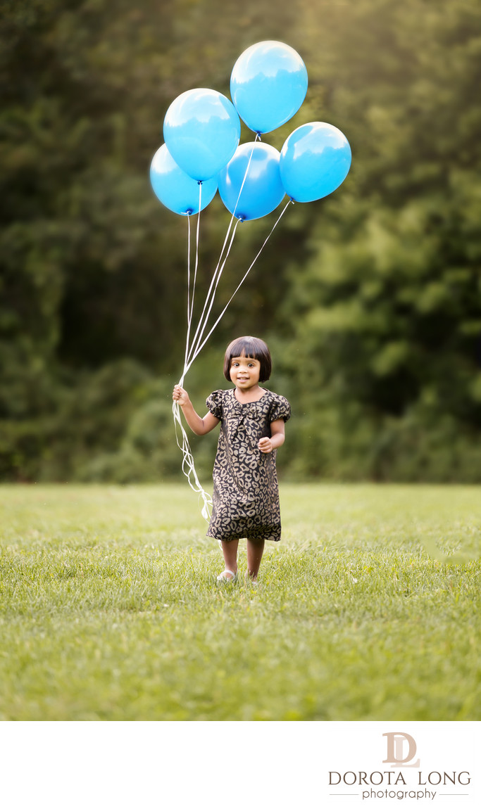 preschool little girl outdoor with baloons