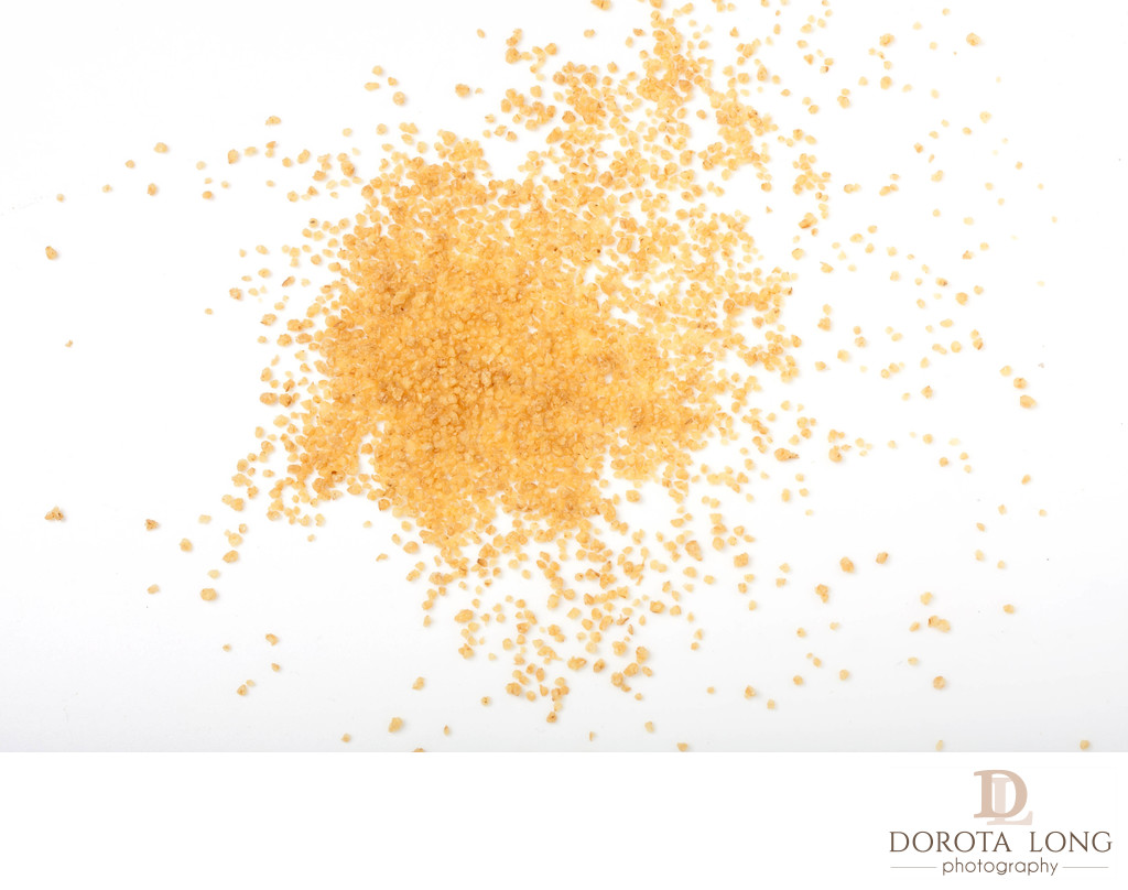 uncooked couscous scattered on white background