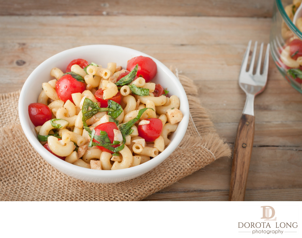 Italian macaroni salad with tomatoes and fresh basil