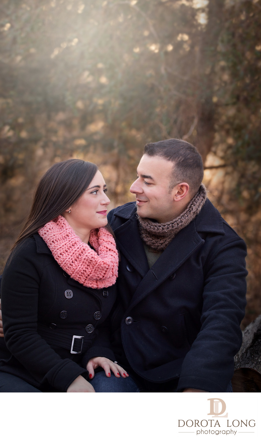 outdoor portrait of a couple wearing dark coats