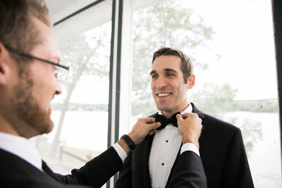 Best man helping the groom get ready. CT Wedding