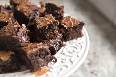 small pieces of brownies on white plate