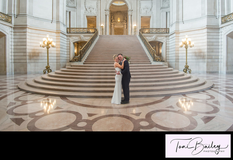 Happily married at grand staircase in San Francisco