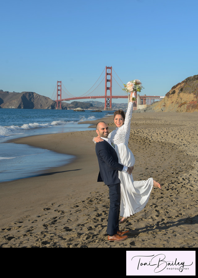 Fun couple at Baker Beach near sunset